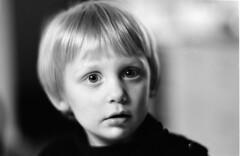 portrait (swedish silver) Tags: portrait blur film zeiss kid dof open bokeh 14 wide 85mm analogue eos3 planar oof