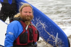 A new fashion in beards? (Frank Fullard) Tags: ocean blue ireland red sea portrait irish fashion beard surf clare surfer wave ponytail lahinch fullard frankfullard lahench