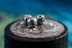 2/20/16 Jingles (Karol A Olson) Tags: detail metal bells lid embossing 84knickknackortrinket 116picturesin2016