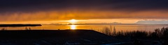 Peeking under the clouds (Eisbier) Tags: sunset panorama sun yellow alaska clouds gold golden nikon 70200 goldenhour cookinlet serine nkkor