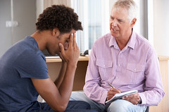 teen individual therapy (inspirationsyouth) Tags: people male men support fifties sad problem indoors listening help together depression africanamerican advice depressed 50s discussion therapy talking unhappy addiction twopeople addict mentalhealth 20s substanceabuse caucasian psychotherapy twenties middleaged counselling socialissue counsellor midage counsellingsession