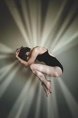 A Sprung Leak (Furcifer07) Tags: light portrait woman sun canon dance shine darkness mark iii levitation portraiture 5d rays conceptual leak position leotard fetal levitate conept