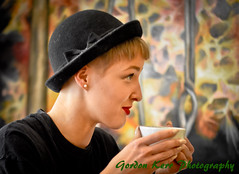 Candid Refreshment (pickup2sticks 6.3 million views) Tags: street uk light red england people urban woman hot color reflection eye girl beautiful face hat fashion closeup female youth digital hair frozen photo hands nikon focus exposure pretty mood different dof hand natural image expression unique quality candid derbyshire flash young lips sharp clothes blond views blonde ambient lipstick derby unaware tonal midlands lightroom focussed gordonkerr
