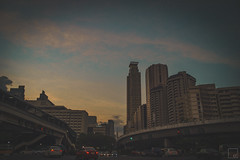 March 27th (christoferfamero) Tags: city sunset sky urban clouds buildings project photography traffic district central cityscapes overpass business 365 makati avenue flyover ayala scapes edsa christoferfamero