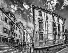 The House At The Corner (derek.dpr) Tags: venice sky bw italy black architecture clouds canal italia noir dramatic streetscene olympus architectural venise venezia bianco nero streetview omd em5 veniceitalybw