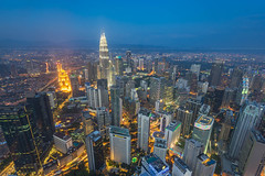 Blue Hour of Kuala Lumpur City (HakiimMislam) Tags: city blue skyline architecture canon outdoor sony wideangle hour malaysia kualalumpur klcc kltower