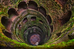 The Masonic Initiation Well of Quinta da Regaleira (fesign) Tags: old history portugal horizontal architecture spiral outdoors photography moss ancient day arch quintadaregaleira sintra tranquility nopeople unescoworldheritagesite well traveldestinations initiationwell colourimage elevatedview builtstructure traditionallyportuguese