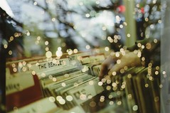 Vynils and lights (Lore Stars) Tags: london film 35mm vintage lights analgica hand bokeh doubleexposure londres fujicolor200 recordshop vynils thebeatles dobleexposicin pentaxmv autochinon50mmf17
