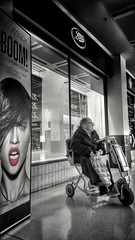 Not in the Mood (Mark.L.Sutherland) Tags: cameraphone red blackandwhite bw man shop advertising scotland highlands waiting boots watching north streetphotography cellphone samsung shoppingcentre oldman lips boom smartphone disabled lipstick sutherland lakeland colorsplash shopfront inverness shoppingbag selectivecolour spotcolour mobilityscooter rihanna smashbox eastgateshoppingcentre phoneography androidography galaxys5