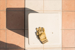 kyoto-0765-ps-w (pw-pix) Tags: morning shadow brown sun white geometric yellow japan lost grey beige kyoto alone pattern angle seat sunny paving glove discarded nijo pavers oneglove outsidenijostation