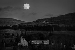 "Full moon over Uig Scotland (steiner2009 ""AKA Dr Dust "") Tags: trees blackandwhite moon mountains church clouds forest scotland village isleofskye hill fullmoon churchyard nightsky uig thesephotosarenottobeusedwithoutmypermission"