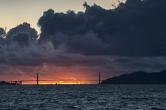 Golden Gate Bridge Burn (Karen Andrea Photography) Tags: bridge sunset sky seascape storm nature clouds landscape bay pacific marin goldengatebridge goldengate bayarea mothernature marinheadlands darkskies ggb stormyskies amazingnature stormpassing sfsanfrancisco kanerphotography karenandreaphotography