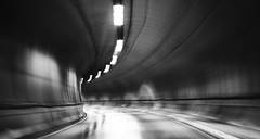 the good thing about life is ... (lunaryuna) Tags: bw monochrome norway blackwhite tunnel motionblur lunaryuna needforspeed lightshadow lofotenislands nouvellevague justathought tunnelcrossing bendinthetunnel
