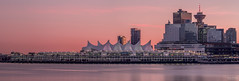 A Glowing Vancouver (Craig Mankey) Tags: ocean city pink sunset canada water beautiful architecture vancouver canon buildings lights amazing downtown cityscape bc skyscrapers britishcolumbia sails christmaslights pacificnorthwest stanleypark westcoast pnw canadaplace sl1 604 harbourcenter downtownvancouver panpacifichotel canon75300mm cruiseshipterminal canonsl1