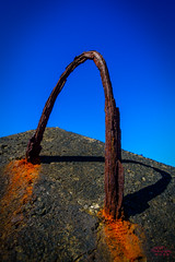 Rusted handle on a concrete block lining the harbour (eggwah123) Tags: shadow abstract colour texture metal closeup zeiss rust raw fuji harbour wideangle rusted fujifilm acr concreteblock carlzeiss ultrawideangle xe1 touit xtrans touit12mm