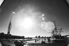 (nic lawrance) Tags: sea blackandwhite sun water architecture boats ship harbour wideangle structure corona portsmouth spinnakertower historical shape hmswarrior