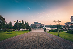 Sunset at Mansudae Fountain Park (reubenteo) Tags: sunset building sunrise landscape asia korea communist communism kimjongil socialist socialism northkorea pyongyang kimilsung kimjongun