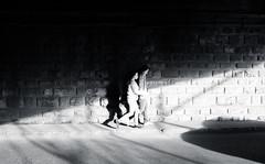 From the Shadows | Day 224 / 365 (marcin baran) Tags: road street city bridge girls light shadow people urban sun lines composition dark walking ray fuji shadows darkness pov pavement walk streetphotography poland polska sunny fujifilm 365 passage gliwice bridhe x100 365project marcinbaran x100t