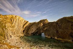 Stair Hole under Moonlight (mpelleymounter) Tags: longexposure cloud moon seascape stars waves april moonlight nightsky startrails lulworth rockformation lulworthcove 2016 jurassiccoast rockstrata sandandsea stairhole cathedralcavern dorsetlandscape dorsetseascape limestonestrata markpelleymounter
