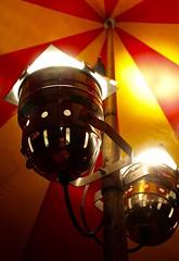 (lewispedervel) Tags: wood light red yellow metal vintage shiny post circus under warmth indoor tent spotlight decor alternative