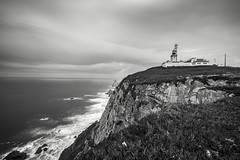 The Lighthouse By The Cliff (BoXed_FisH) Tags: travel sea blackandwhite bw cliff lighthouse beach portugal monochrome clouds landscape mono spain sony wideangle monotone edge colares cabodaroca sonyalpha sonyzeiss zeiss1635 sonya7 sel1635z sony1635mmvariotessartfef4zaoss sonyzeiss1635f4oss