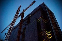 Rise of the Evil Empire (bombeeney) Tags: seattle city urban building dark corporate scary amazon crane corporation pnw evilempire