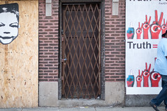 (129/366) Syllogism (CarusoPhoto) Tags: street door city urban baby chicago man face project john 50mm photo gate day pentax walk 365 f18 caruso smc ks2 366 syllogism pentaxda carusophoto