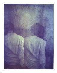sisters (www.matteovarsi.com) Tags: portrait woman hair polaroid back shoulders redhair expiredfilm doubleexposures bluish 669expiredfilmr