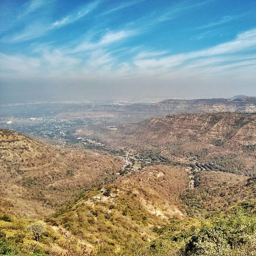 The #city of #Pune, seen on the way to the Sinhagad #fort. I was surprised to see the #grey band (city #pollution?) that starkly divided the land and the #blue #sky. #hdr #mountains #hills #sky