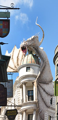 Angry Escapee (Seeing Visions) Tags: sky signs architecture clouds us orlando wings dragon unitedstates florida harrypotter dome fl themepark 2015 universalstudiosorlando diagonalley gringotts raymondfujioka