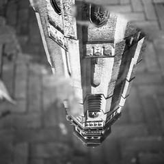 Upside down (Wouter de Bruijn) Tags: street blackandwhite reflection tower 6x6 film water monochrome rain analog zeiss mediumformat square puddle bricks churchtower hasselblad squareformat ilfordxp2super ilford 80mm 500cm langejan