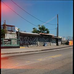 Closed shops above Hunters Point Avenue Station, Queens (Patrick Copley) Tags: nyc abandoned tlr film mediumformat lost closed kodak 120film lightleak queens subwaystation lirr nycsubway latesummer semflex queensnewyork hunterspointavenue blazingsun lostnyc ektar100 semflex154 semflexsemioto hunterspointavenuestation hunterspointavenuerailroadstation