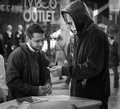Ninja with a fan (Nikonsnapper) Tags: street fan ninja candid cardiff olympus bin disguise unposed zuiko 45mm omd em5