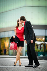 Greeting - young couple in red (matulio) Tags: street friends red two people urban woman man building male love boyfriend beautiful female youth real outside happy person kiss kissing girlfriend couple legs outdoor young formal lifestyle happiness romance professional business suit relationship together dating attractive romantic colleagues welcome elegant handbag greeting meet crossed caucasian fulllenght