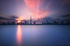 Dancing City... (Charlie_Joe) Tags: longexposure sunset nature silhouette skyline architecture clouds creek skyscraper dubai cityscape uae emirates bluehour unitedarabemirates cloudscape tallest gnd leefilters burjkhalifa leebigstopper