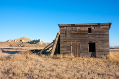 1560_-Montana-USA.jpg (lenspiration1) Tags: old morning blue sky brown grass barn landscape golden countryside ancient montana perspective western badlands prairie gass dilapidated bluff antiquated unused
