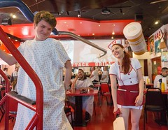 Ouch that smarts (googling2000g) Tags: las vegas red sexy hair restaurant outfit heart burger attack paddle inside nurse waitress spank heartattack freemont discipline