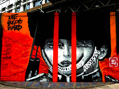 Ives One (Draopsnai) Tags: streetart soldier graffiti mural guard shoreditch fencing redandblack hoardings ivesone