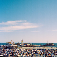 Santa Monica Pier...and Parking Lot (methezer) Tags: ocean california vacation color film beach analog pier kodak outdoor santamonica daytime portra