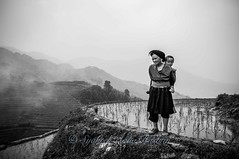 At the top... (Syahrel Azha Hashim) Tags: china morning travel light boy vacation bw mountain holiday detail love blackwhite nikon dof grandmother guilin getaway traditional chinese naturallight tokina handheld shallow moment 16mm paddyfields highaltitude traditionalclothing ultrawideangle d300s syahrel longjipaddyterrace