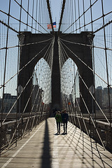 Brooklyn Bridge (Igor Voller) Tags: new wood york city bridge blue sky people usa sunlight building metal stone brooklyn us arch leute flag rope tourist walkway brcke holz stein             sonnenlicht