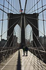 Brooklyn Bridge (Igor Voller) Tags: new wood york city bridge blue sky people usa sunlight building metal stone brooklyn us arch leute flag rope tourist walkway brücke holz stein 空 青 人 アメリカ 橋 ニューヨーク небо 日 металл дерево люди тень sonnenlicht флаг мост камень солнечный сша блик туристы синее ньюйорк бруклин трос бруклинский ブルクリン