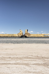Railroad Cars (autobahn66.com) Tags: railroad blue sky yellow clouds train desert minimal transportation minimalist bleached saltonsea claifornia bombaybeach steelgraffiti