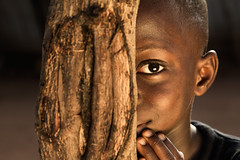 Assou. The Shy Boy... (Sylvie.) Tags: boy tree canon hoop is dof child shy orphan togo usm efs f28 1755 jongen canonefs1755f28isusm canon60d assou wwwjokotogocom