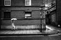 Lonesome Beauty (nigelhunter) Tags: china road street woman wet girl beauty rain umbrella way manchester one town pavement candid brunette