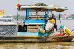 The Floating Life (nadeeshacabral) Tags: poverty family people river boat fishing vietnam mekong