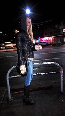 The Eclipse (lost.mohican) Tags: street blue urban woman black eye beautiful face leather bike standing hair bag one streetlight long neon boots profile gray platform knit hidden sidewalk jeans jacket gloves rack blonde half mysterious heels hood oversized emerging wedge slender