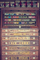 Vintage store thread display. (barbroehler) Tags: wood thread minnesota goods generalstore vintagestore harkinstore sunlionimagerycom