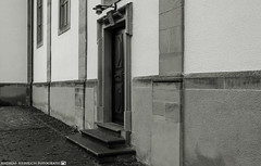 The side entrance of the Church. (andreasheinrich) Tags: blackandwhite church architecture germany deutschland march cloudy kirche rainy architektur regnerisch badenwürttemberg blackandwhitephotos bewölkt neckarsulm schwarzweis nikond7000
