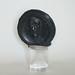 Medalla realizada por el escultor Ricardo Giannetti, para la Fundación El Libro, organizadora de la Feria Internacional del Libro de Buenos Aires, con motivo de la Feria dedicada a Borges en 1987. Esta es una pieza especial por estar sin cortar y estar hecha en bronce